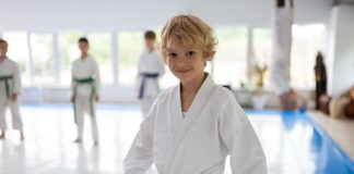 Martial arts boy in class