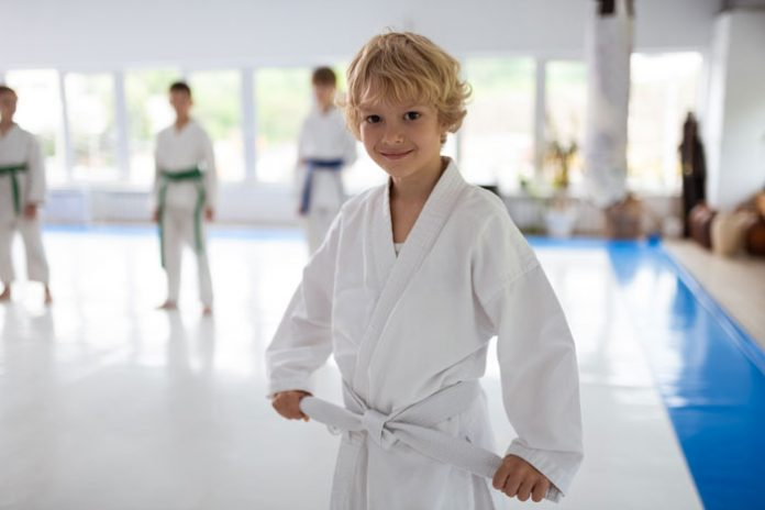Martial arts boy in class